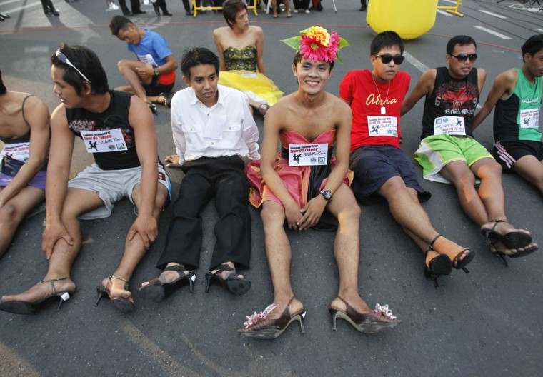 Male Tour De Takong (Stiletto Race) participants rest before running along the 500 m stretch of Shoe Avenue in Marikina City, east of Manila. The race, which is annual event, requires participants to wear high heels that measure a minimum of 3 inches and a 1.5 centimeters tip diameter. The Tour De Takong is part of the Shoes Festival, which started on September 10 and will end on December 31. (Romeo Ranoco/Reuters)