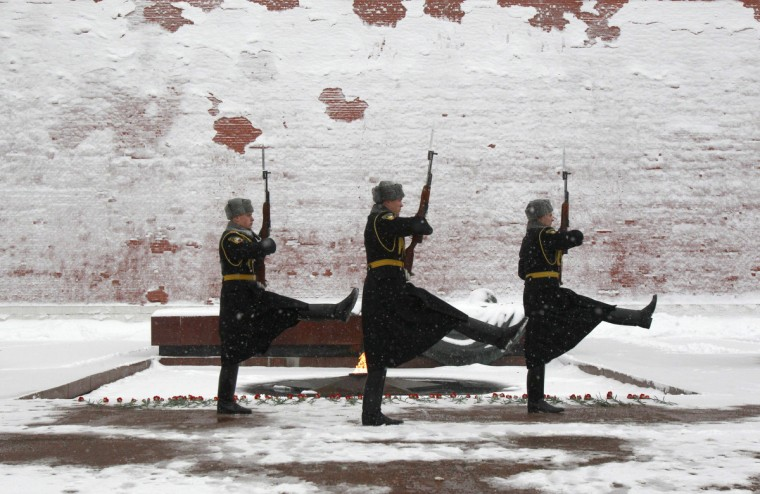 Honor guards march at the Tomb of the Unknown Soldier by the Kremlin wall during a heavy snowfall in central Moscow. (Sergei Karpukhin/Reuters)
