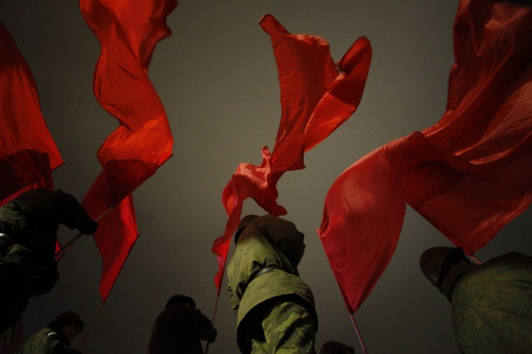 Russian servicemen hold flags during a military parade rehearsal in Red Square in Moscow. (Maxim Shemetov /Reuters)