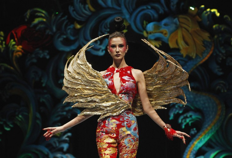 A model presents a creation by Chinese designer Guo Pei during the Asian Couture fashion show in Singapore (Edgar Su/Reuters)