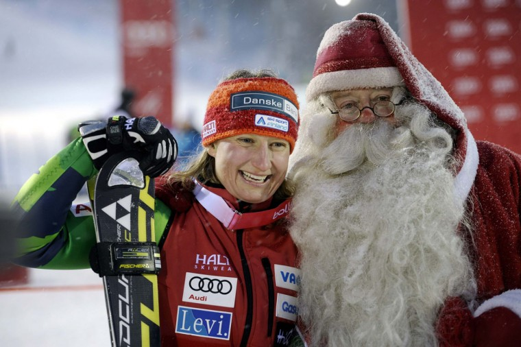Finland's Tanja Poutiainen (L) celebrates her second place finish with a man dressed as Santa Claus after the second run of the women's slalom at the FIS Alpine Ski World Cup Levi in Kittila November 10, 2012. (Heikki Saukkomaa/Lehtikuva/Reuters)