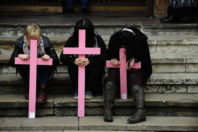 People take part in a protest against violence directed at women, in front of a church at the town hall in Oviedo November 25, 2012. The United Nations General Assembly has designated Sunday to be the International Day for the Elimination of Violence against Women. (Eloy Alonso/Reuters)