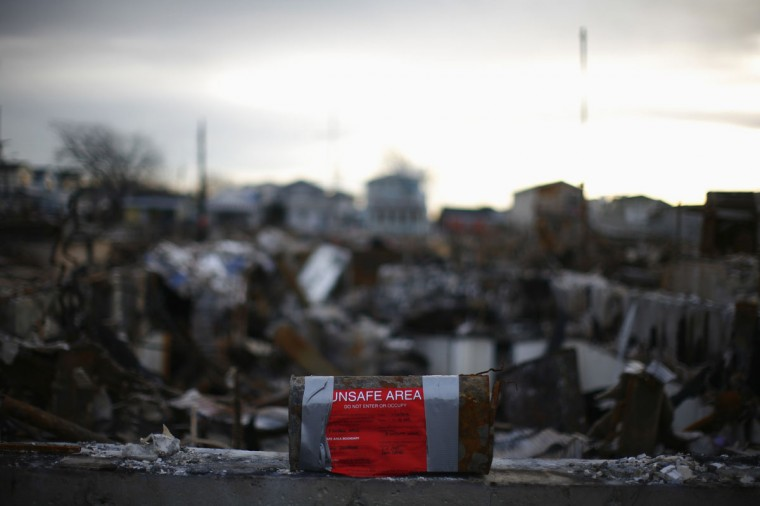 A mailbox with a warning notice is seen in front of a home destroyed by Storm Sandy in the Breezy Point neighborhood of Queens, New York. (Eric Thayer/Reuters)