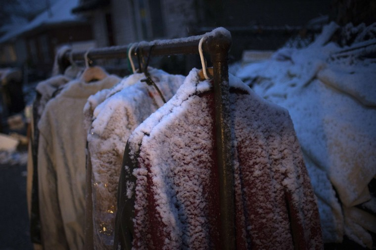Snow covers clothes hanging outside a home, which was left destroyed by Hurricane Sandy, in the Staten Island borough of New York November 7, 2012. A wintry storm dropped snow on the U.S. Northeast on Wednesday and threatened to bring dangerous winds and flooding to a region still climbing out from the devastation of Superstorm Sandy. (Adrees Latif/Reuters)