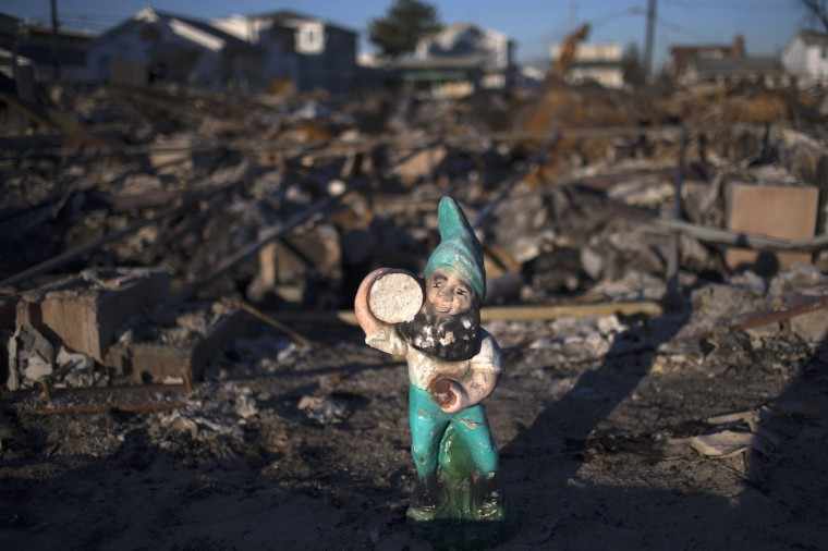 A gnome is seen in the yard of a burnt home in the Breezy Point neighborhood which were left devastated by Hurricane Sandy in the New York borough of Queens. (Adrees Latif/Reuters)