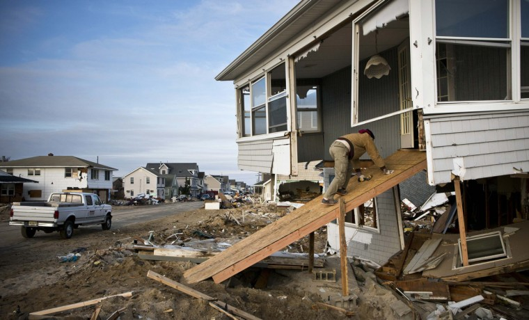 Randy Micale enters his father's home through a home-made ramp while cleaning up the property, which was damaged by Hurricane Sandy, in the Ortley Beach area of Toms River, New Jersey. The storm made landfall along the New Jersey coastline on October 29. (Andrew Burton/Reuters)
