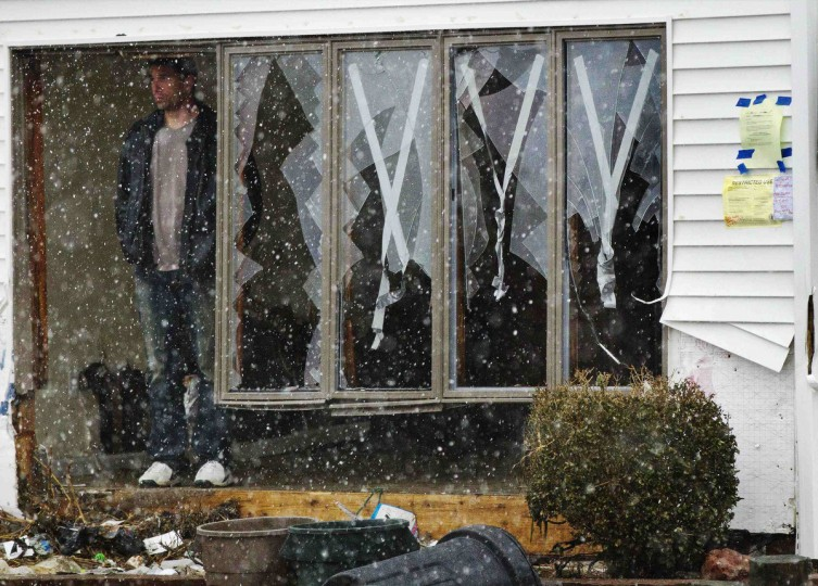 Homeowner Chris Brady stands at a wall of windows damaged by Hurricane Sandy to watch snow fall during nor'easter, also known as a northeaster storm in Lindenhurst, New York November 7, 2012. The wintery nor'easter storm added misery to thousands of people whose homes were destroyed by superstorm Sandy, which killed 120 people when it smashed ashore on October 29 in the New York-New Jersey area, swallowing entire neighborhoods with rising seawater and blowing homes from their foundations. (Lucas Jackson/Reuters)