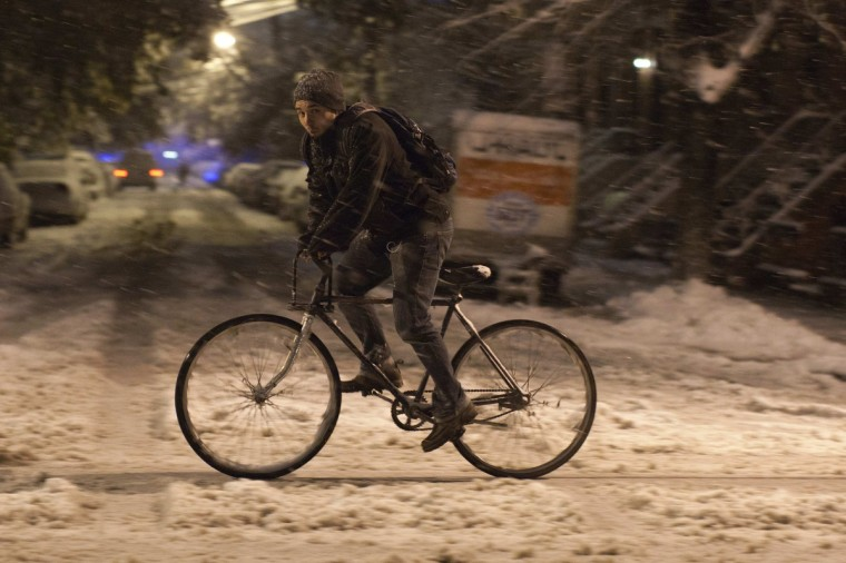 A man rides his bike in the snow during the nor'easter, also known as a northeaster storm, in Jersey City, New Jersey November 7, 2012. A wintry storm dropped snow and rain on the U.S. Northeast on Wednesday, bringing dangerous winds and knocking out power in a region where hundreds of thousands were still in the dark after Superstorm Sandy. (Eduardo Munoz/Reuters)