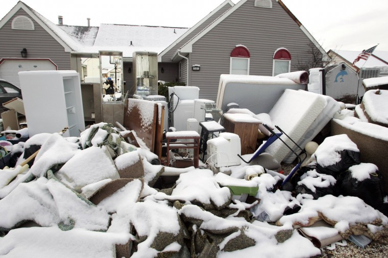 A pile of belongings, coated with a few inches of snow, is seen outside a home in the West Beach Haven community of Manahawkin, New Jersey November 8, 2012 as recovery efforts continue in the aftermath of Hurricane Sandy. A nor'easter Wednesday in New York and New Jersey knocked power out for hundreds of thousands of people and slowed utilities' efforts to restore service to more than 600,000 still without power in the wake of superstorm Sandy. (Tom Mihalek/Reuters)