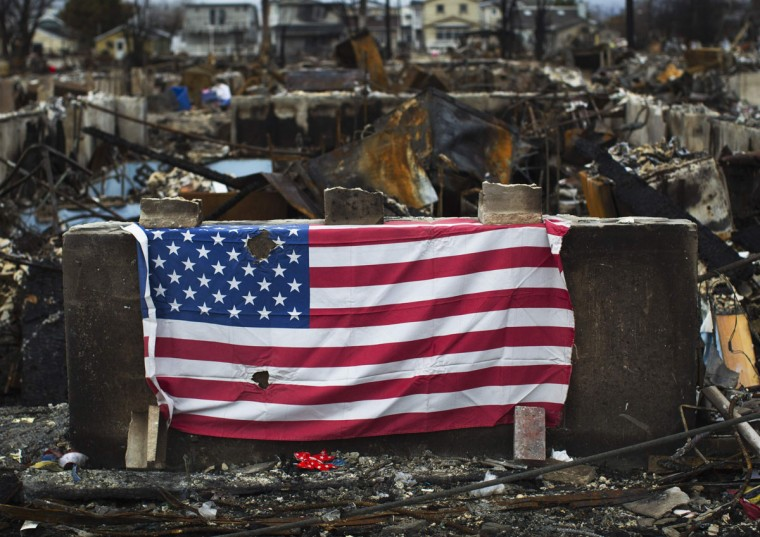 An American flag is seen outside a home damaged by fires and Superstorm Sandy in the Breezy Point section of the Queens borough of New York. (Shannon Stapleton/Reuters)