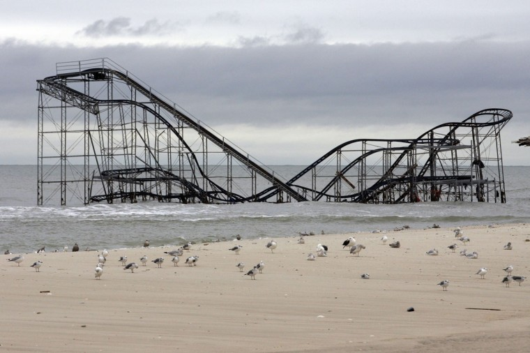 The extensive damage to an amusement park roller coaster in the aftermath of Hurricane Sandy is seen in Seaside Heights, New Jersey. Residents of New York and New Jersey were told to prepare for a long recovery from Superstorm Sandy, as thousands of people grappled with cleaning up their properties, the extended lack of electricity and gasoline shortages nine days after the storm. (Tom Mihalek/Reuters)