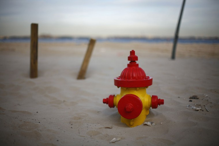 A fire hydrant is seen buried in the sand in the Breezy Point neighborhood of Queens, New York. (Eric Thayer/Reuters)