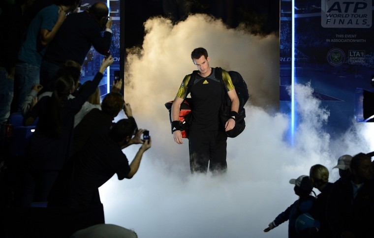 Fans reach out to take photographs of Britain's Andy Murray as he walks onto court for his men's singles tennis match against Serbia's Novak Djokovic at the ATP World Tour Finals in the O2 Arena in London (Dylan Martinez/Reuters)