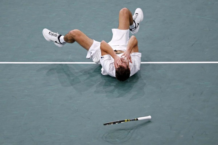 Poland's Jerzy Janowicz celebrates after winning his match against Andy Murray of Britain during the Paris Masters tennis tournament. (Benoit Tessier/Reuters photo)