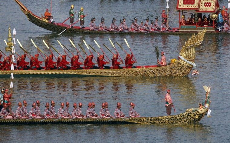Thai oarsmen row a royal barge during a dress rehearsal for Royal Barge Procession, on the Chao Phraya River in Bangkok, Thailand. The Royal Barge Procession, the 700 year-old Thai traditional ceremony, will be held on November 9 to mark the end of Buddhist lent day and to celebrate the 85th Birthday of King Bhumibol. (Chaiwat Subprasom/Reuters)