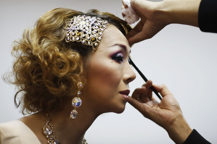 Tukishima Beni, a contestant from Japan, gets her make-up done before the start of the final night of Miss International Queen 2012 transgender/transsexual beauty pageant in Pattaya, Thailand. Some 21 contestants from 15 countries, all of them born male, compete in the week-long event for the crown of Miss International Queen 2012. (Damir Sagolj/Reuters)