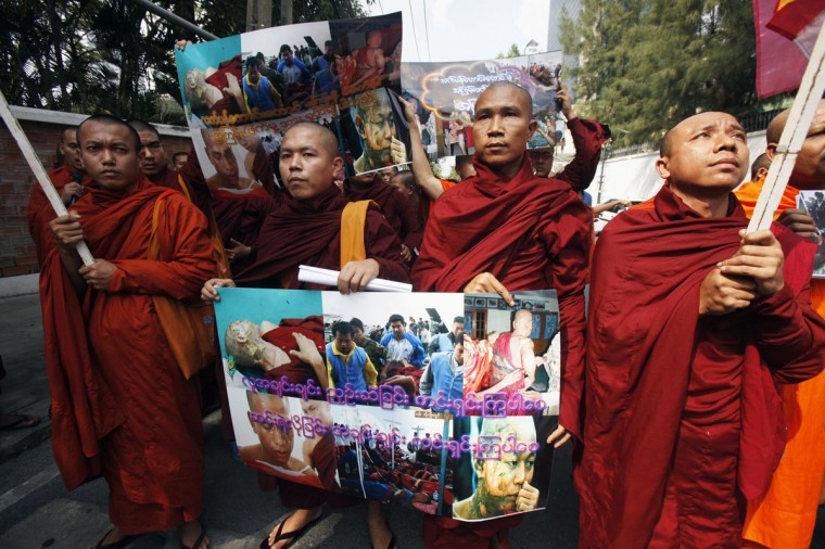 Buddhist monks from Myanmar, living in Thailand, carry pictures as they protest in front of the Myanmar embassy in Bangkok. They submitted a letter to Myanmar's president and demonstrated against the recent police crackdown on protesters, who were against a copper mining project at the Sagaing region in Myanmar's northwest. (Chaiwat Subprasom/Reuters)