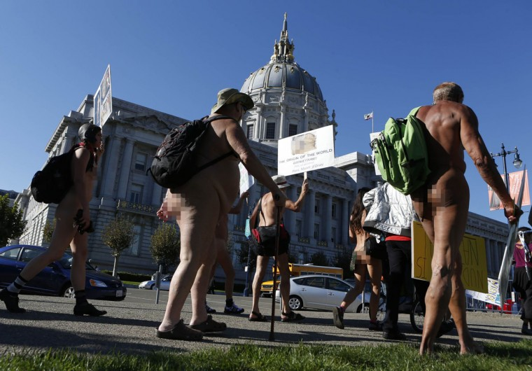 Nudists march past city hall during a rally against banning nudity in parts of the city in San Francisco, California, November 14, 2012. (Beck Diefenbach/Reuters)