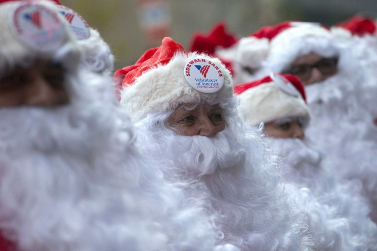 Some dozens of Santas march through Midtown Manhattan during the Volunteers of America's 110th Annual Sidewalk Santa Parade in New York. (Adrees Latif/Reuters)