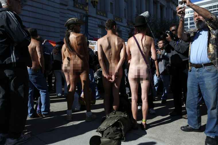 Nudists listen to speakers during a rally against banning nudity in parts of the city in San Francisco, California, November 14, 2012. (Beck Diefenbach/Reuters)