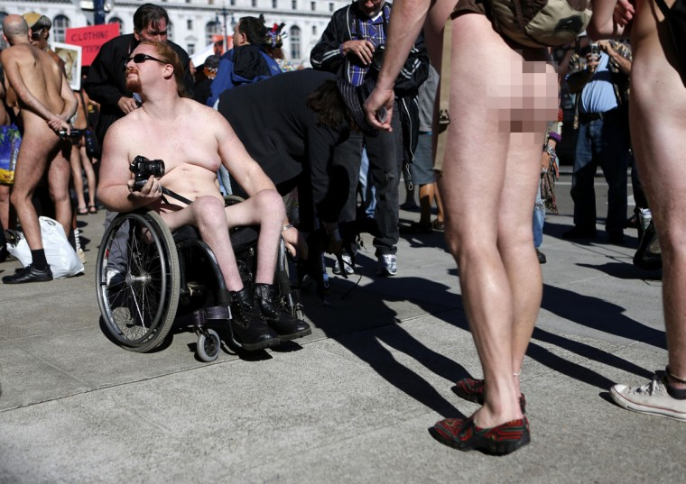 Michael Sundin, of Napa, talks with fellow nudists following a rally against banning nudity in parts of the city in San Francisco, California, November 14, 2012. (Beck Diefenbach/Reuters)