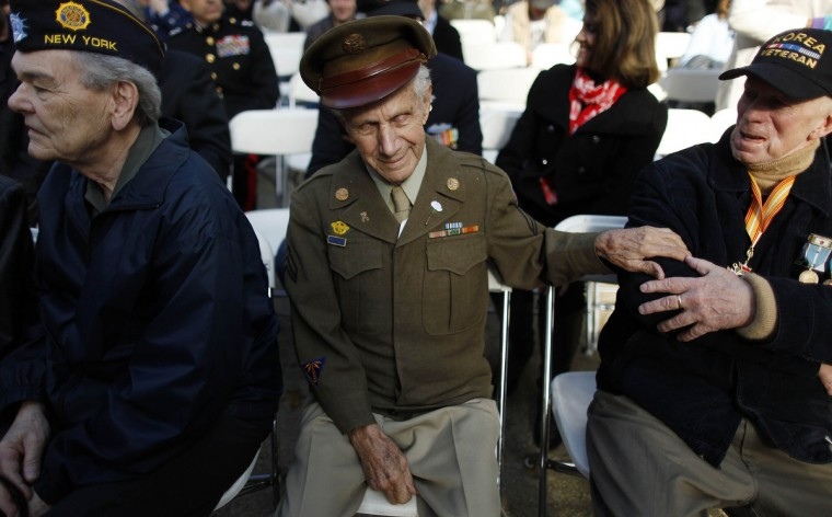 Veterans sit and talk at the start of the Veterans Day Parade in New York November 11, 2012. (Carlo Allegri/Reuters)