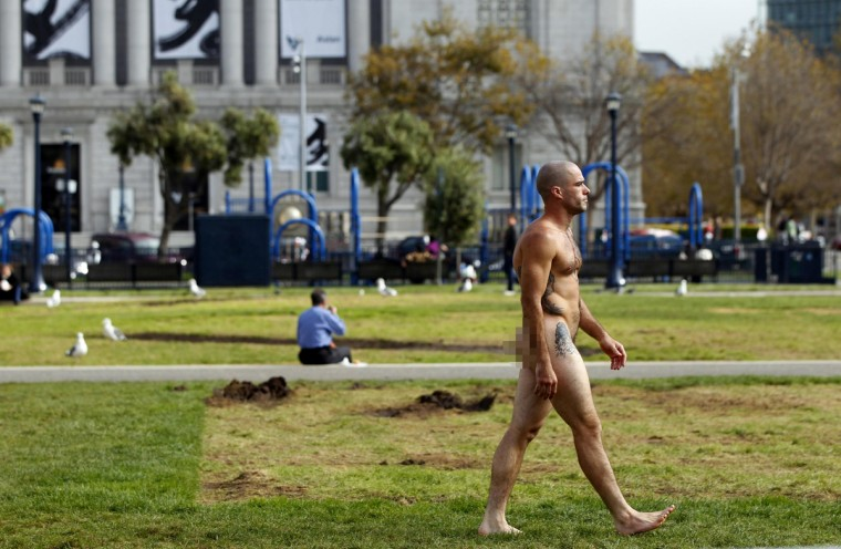 A man, who identified himself as Ocean, walks nude through Civic Center Plaza in San Francisco, California October 30, 2012. (Robert Galbraith/Reuters)