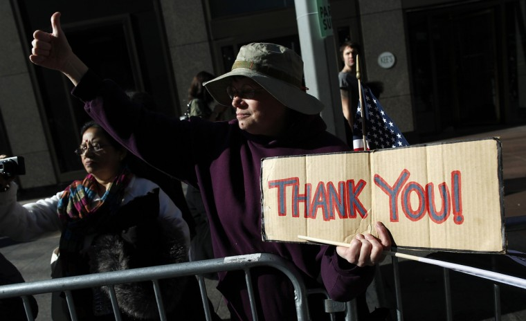 "A woman holds up a ""Thank You"" sign during the Veterans Day Parade in New York November 11, 2012. (Carlo Allegri/Reuters)"