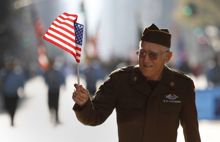 A veteran marches up 5th Avenue during the Veterans Day Parade in New York November 11, 2012. (Carlo Allegri/Reuters)