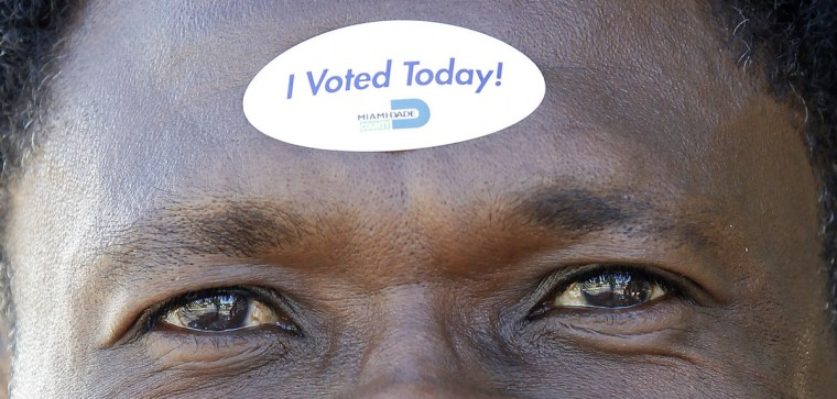Jean Robert Soutien displays on his forehead the sticker he received after voting during the U.S. presidential election in North Miami Beach, Florida November 6, 2012. (Andrew Innerarity/Reuters)