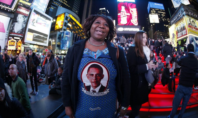 Marta Nunez from Honduras wears a Barack Obama dress as she watches TV screens in Times Square giving U.S presidential election results in New York November 6, 2012. (Carlo Allegri/Reuters)