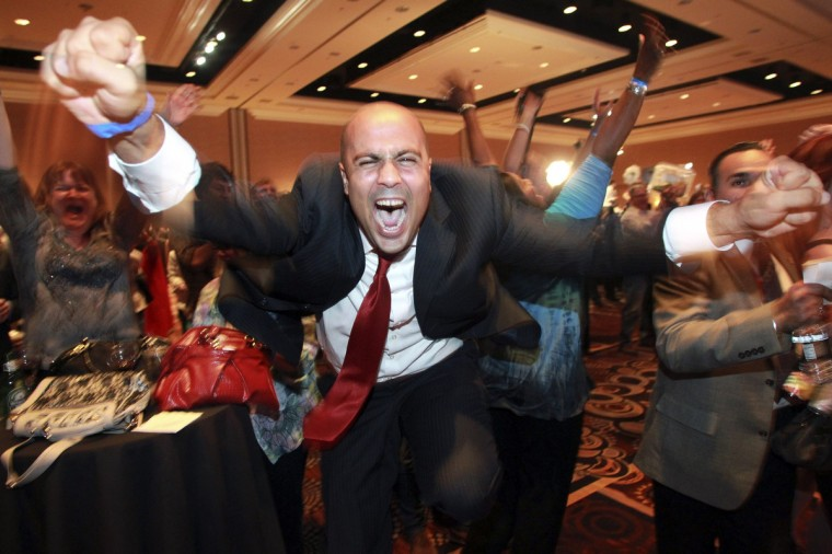 Ajay Narayan cheers as the race is called for U.S. President Barack Obama by a television network during the Nevada State Democrats' election night party at the Mandalay Bay Resort in Las Vegas, Nevada November 6, 2012. (Sam Morris/Las Vegas Sun)