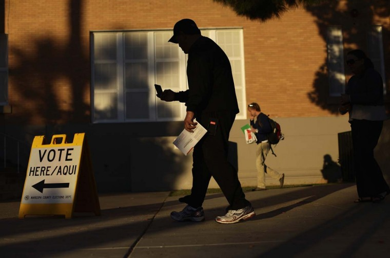 PHOENIX, AZ: Gilbert Zermeno holds his ballot as he prepares to drop it into a ballot box at Kenilworth School during the U.S. presidential election in Phoenix, Arizona November 6, 2012. (Joshua Lott/Reuters)