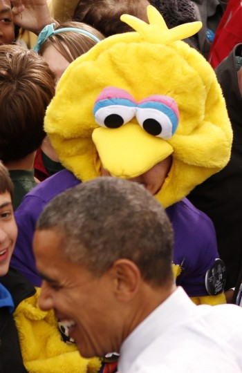 A woman dressed as Sesame Street's Big Bird greets U.S. President Barack Obama during a campaign rally in Denver. After Republican challenger Mitt Romney pledged to stop the U.S. subsidy for the Public Broadcasting Service despite his professed love for Big Bird, the Sesame Street character became a symbol for Obama's supporters. (Kevin Lamarque/Reuters)