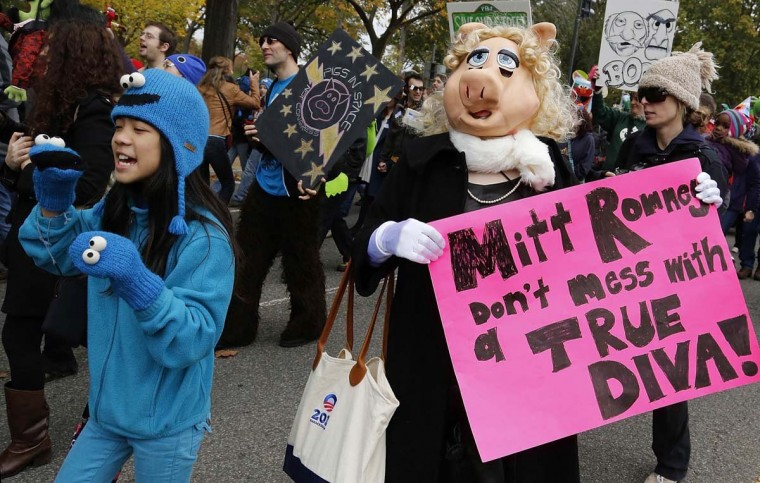 Protesters wearing Cookie Monster and Miss Piggy costumes walk in the Million Muppet March in support of federal funding for public television, in Washington, November 3, 2012. (Jonathan Ernst/Reuters)
