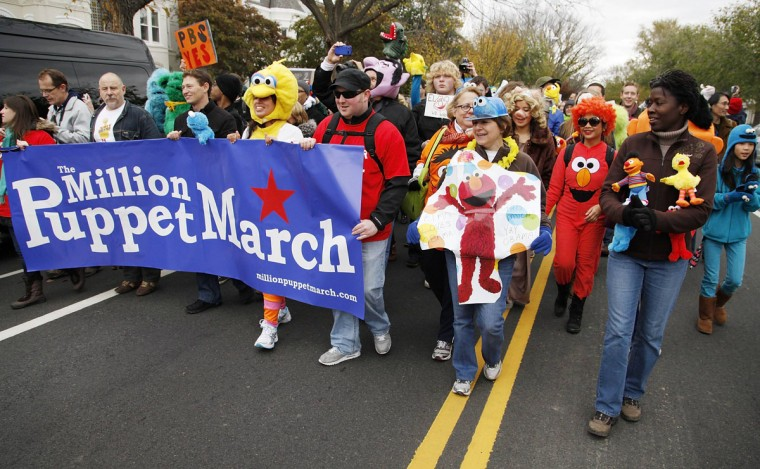 Protestors with puppets walk in the Million Muppet March in support of federal funding for public television, in Washington, November 3, 2012. The rally was held to support federal funding for public television after Republican presidential candidate Mitt Romney pledged to end the U.S. federal government's subsidy for the Public Broadcasting Service despite his professed love for Big Bird. (Jonathan Ernst/Reuters)