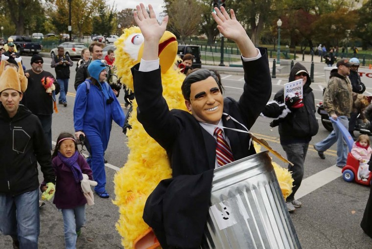Eric Cardwell wears a costume depicting Big Bird carrying U.S. Republican presidential candidate Mitt Romney in a trash can during a Million Muppet March in support of federal funding for public television, in Washington, November 3, 2012. (Jonathan Ernst/Reuters)