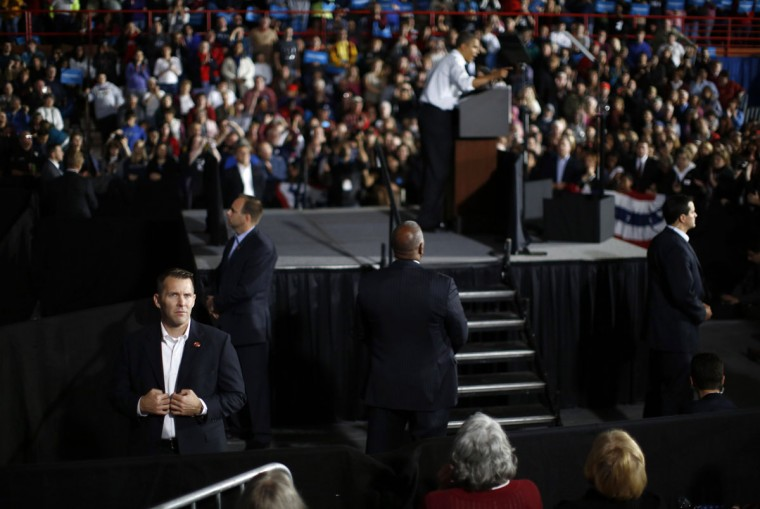 Secret Service agents surround the stage where U.S. President Barack Obama speaks during a campaign rally at Mentor High School in Mentor, Ohio. (Jason Reed/Reuters)