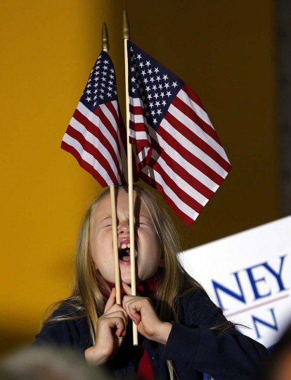 A girl cheers during a campaign event with Republican presidential nominee Mitt Romney at Integrity Windows in Roanoke, Virginia November 1, 2012. (Brian Snyder/Reuters photo)
