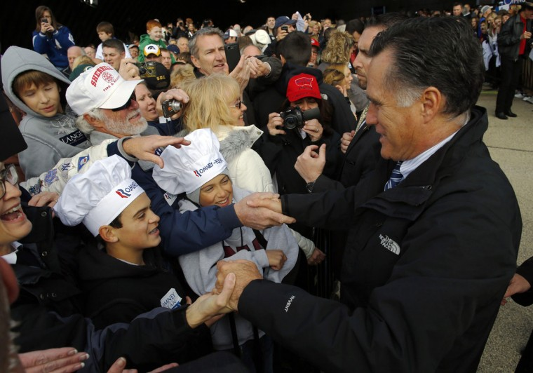 Republican presidential nominee Mitt Romney greets audience members wearing Romney-Ryan chef's hats at a campaign rally in Dubuque, Iowa. (Brian Snyder/Reuters)