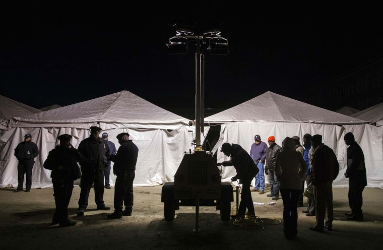 NY: Poll workers attempt to start a generator to power a polling site for the U.S. presidential election built to service residents of the Queens borough neighborhoods of Breezy Point and the Rockaways whose original site was damaged during hurricane Sandy in New York, November 6, 2012. (Lucas Jackson/Reuters)