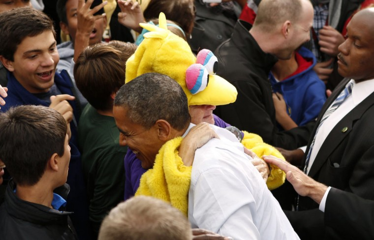 U.S. President Barack Obama gets a hug from a woman dressed as Sesame Street's Big Bird during a campaign rally in Denver. After Republican challenger Mitt Romney pledged to stop the U.S. subsidy for the Public Broadcasting Service despite his professed love for Big Bird, the Sesame Street character became a symbol for Obama's supporters. (Kevin Lamarque/Reuters)