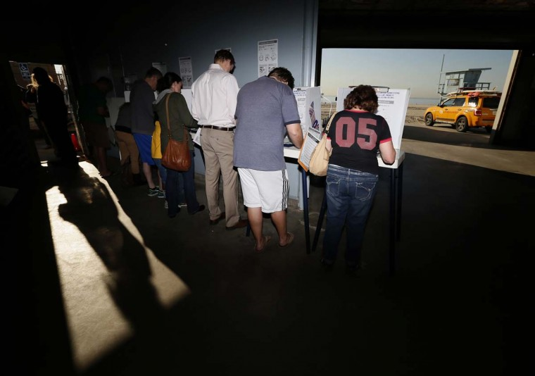 People vote in the U.S. presidential election at Venice Beach lifeguard station in Los Angeles, California November 6, 2012. (Lucy Nicholson/Reuters)