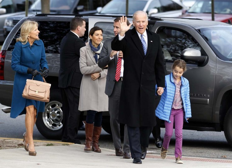 GREENVILLE, DE: U.S. Vice President Joe Biden holds the hand of his granddaughter Natalie as he arrives with his family to vote during the U.S. presidential election in Greenville, Delaware November 6, 2012. (Kevin Lamarque/Reuters)