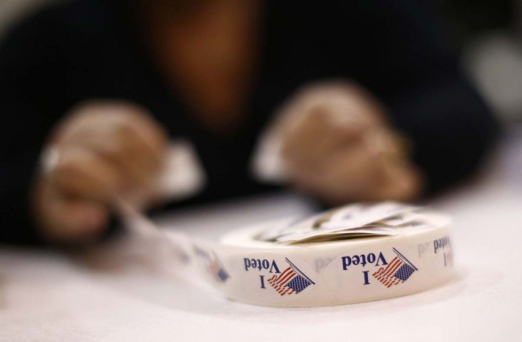 PINEVILLE, NC: A poll worker prepares 'I Voted' stickers at Harrison United Methodist Church during the U.S. presidential election in Pineville, North Carolina November 6, 2012. (Chris Keane/Reuters)
