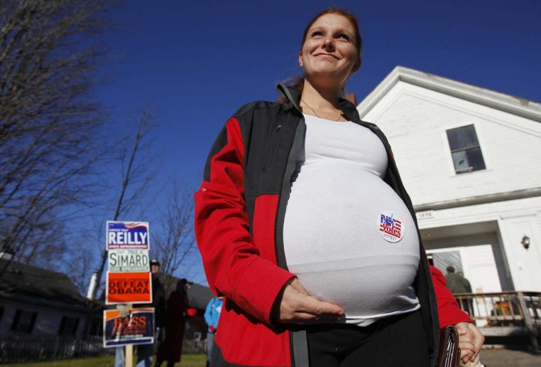 BRISTOL, NH: Samantha Pelletier shows off the voting sticker that was placed on her pregnant belly outside of the old Town Hall during the U.S. presidential election in Bristol, New Hampshire November 6, 2012. (Jessica Rinaldi/Reuters)