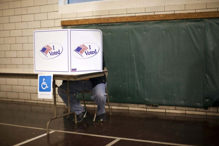 INDIANAPOLIS, IN: People vote at Holy Cross School during the U.S. presidential election in Indianapolis, Indiana, November 6, 2012. (Aaron Bernstein/Reuters)