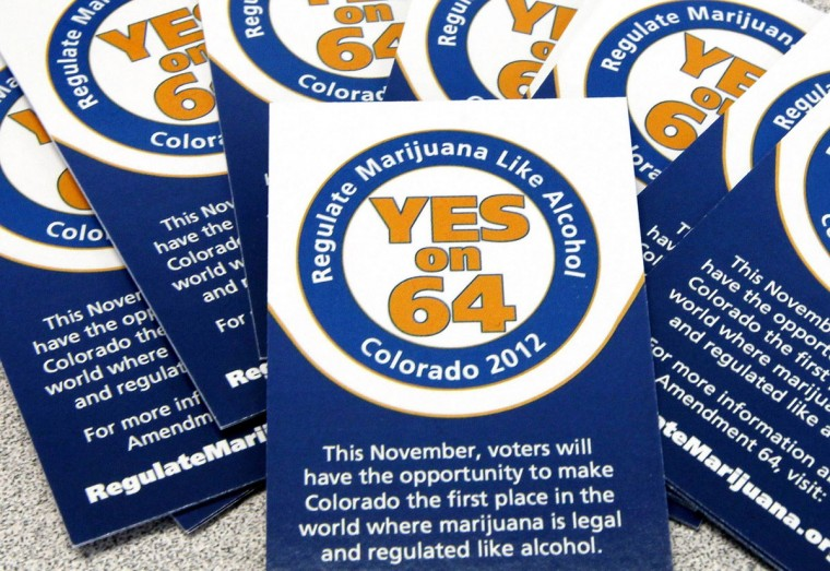 November 8, 2012: Votes making Colorado and Washington the first U.S. states to legalize marijuana for recreational use could be short-lived victories for pot backers because the federal government will fight them, two former U.S. drug control officials said. In this May 25, 2012 file photo, cards supporting Amendment 64 are seen in campaign offices in Denver, Colorado. (Rick Wilking/Files/Reuters)