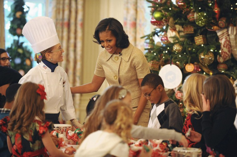 U.S. first lady Michelle Obama smiles near children as military families, including Gold Star and Blue Star parents, spouses and children visit for the first viewing of the 2012 holiday decorations at the White House in Washington. (Mary F. Calvert/Reuters)
