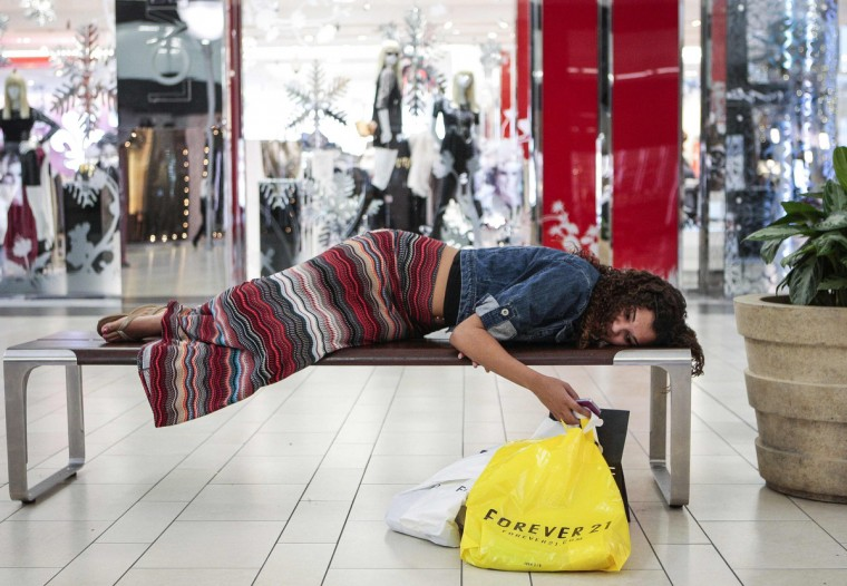 Jasmine Britton, 18, of Huntington Beach rests while shopping at the Los Cerreitos Center mall on Black Friday in Cerritos, California. Black Friday, the day following the Thanksgiving Day holiday, has traditionally been the busiest shopping day in the United States. (Bret Hartman/Reuters)